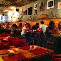 Photo taken at John John Cafe by João F. on 11/29/2012