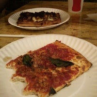 Photo taken at Garlic New York Pizza Bar by Vishal K. on 9/29/2013