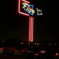Photo taken at Flips Patio Grill by Sitia F. on 12/8/2012