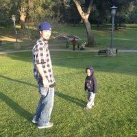 Photo taken at Garfield Park by Kalika K. on 2/19/2013