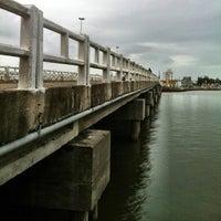 Photo taken at Ponte Giuseppe Garibaldi (Ponte Tramandaí - Imbé) by Cassiano G. on 8/23/2013