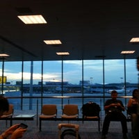 Photo taken at Terminal 1 Departure Hall by Gabrielle X. on 4/17/2013