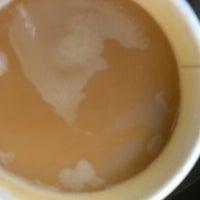 Photo taken at Slow Train Coffee by Erik N. on 9/18/2012