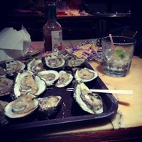 Photo taken at Cooter Brown's Tavern & Oyster Bar by Ashley on 11/17/2013