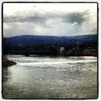 Photo taken at South Washington Street Bridge by Joshua A. on 3/26/2013