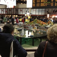 Photo taken at South Station Food Court by Tina C. on 12/5/2012