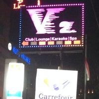 Photo taken at V2 Lounge Bar & Karaoke by LeinaD H. on 11/23/2013