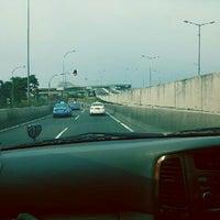 Photo taken at Jalan Tol Lingkar Luar Jakarta Seksi W1 (JORR W1) by Philip P. on 9/10/2013