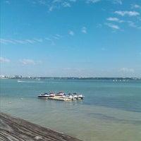 Photo taken at Boardwalk Behind Shoppes Of Sand Key by Erael B. on 11/17/2012
