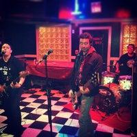 Photo taken at News Cafe by Jon K. on 11/24/2012