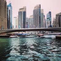 Photo taken at Dubai Marina Walk by Emerson P. on 4/11/2013