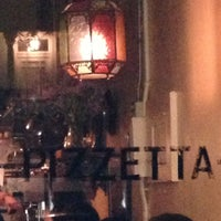 Photo taken at Pizzetta 211 by Amy B. on 4/19/2013