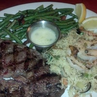 Photo taken at Tahoe Joe's Famous Steakhouse by Angie A. on 3/16/2013