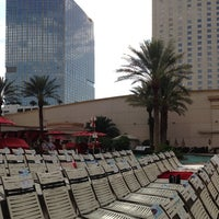 Photo taken at Pools at Monte Carlo Resort & Casino by Brian L. on 6/30/2013