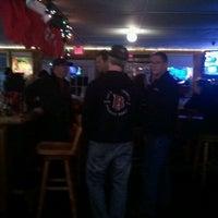 Photo taken at Ox Lake Tavern by Brad G. on 12/9/2012