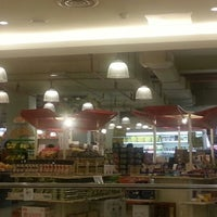 Photo taken at Village Grocer by Joanne T. on 3/24/2013