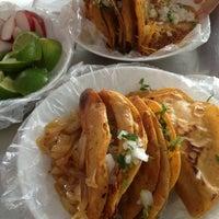 Photo taken at Tacos El Güero Transito by Carlos M. on 1/17/2013