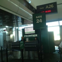 Photo taken at Frontier Airlines (Gates 24 - 32) by Lisa J. on 5/17/2013