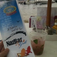 Photo taken at The NASWA Resort - Beach Bar & Grill by Jay S. on 8/3/2014