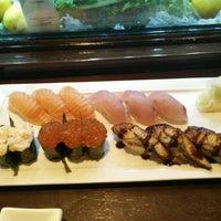 Photo taken at Okura Robata Sushi Bar and Grill by Arthur S. on 5/22/2016