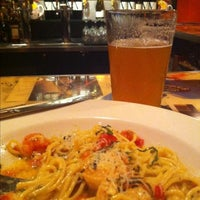 Photo taken at Three Tomatoes Trattoria by Lindsey G. on 8/3/2013