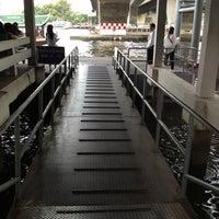 Photo taken at Tak Sin Pier by Teh K. on 4/18/2013