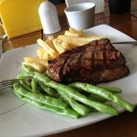 Photo taken at Me'nate Steak Hub by Zain B. on 2/2/2013