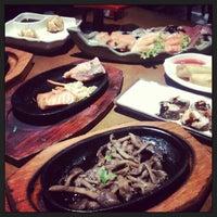 Photo taken at Sushi Nakay by Bruna C. on 7/28/2013