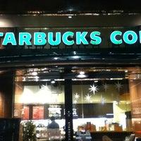 Photo taken at Starbucks Coffee by kazuki01 on 12/23/2012