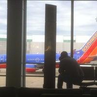Photo taken at Gate 8 by Jasper W. on 2/11/2013