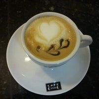 Photo taken at Café Petit by Sae K. on 10/19/2012
