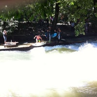 Photo taken at Eisbach Wave by Till W. on 7/8/2012