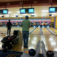 Photo taken at Strike Zone by Brittany B. on 10/25/2011