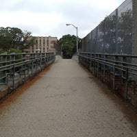 Photo taken at East 8th Street Footbridge by Justin W. on 6/12/2012