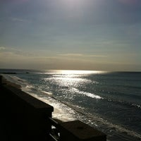Photo taken at Spiaggia allo Scoglio by Ambrogio A. on 12/6/2011