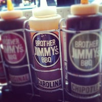 Photo taken at Brother Jimmy's BBQ by Bryan B. on 7/4/2012