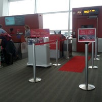 Photo taken at Gate A6 by Eileen R. on 8/19/2012