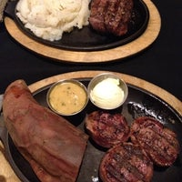 Photo taken at Sweetwater Steakhouse by Tina S. on 7/3/2012