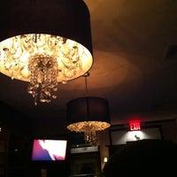 Photo taken at Stella Manhattan Bistro by Keisha R. on 2/20/2012