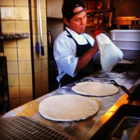 Photo taken at Olio Wood Fired Pizzeria by Mani B. on 9/23/2012