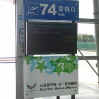 Photo taken at Gate 74 by Iurii on 3/25/2013