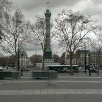 Photo taken at Place de la Bastille by Alexander V. on 4/10/2013