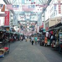 Photo taken at Petaling St. (茨厂街 Chinatown) by Pak K. on 10/8/2012