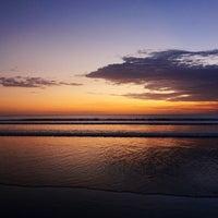Photo taken at Pantai Kuta (Kuta Beach) by Koji O. on 5/1/2013