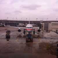 Photo taken at Gate C4 by Carlos M. on 5/15/2013