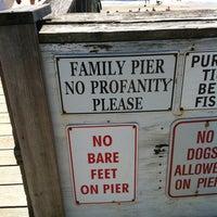 Photo taken at Oak Island Pier by Brad T. on 7/7/2013