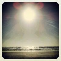 Photo taken at Praia de Imbé by Renato P. on 11/25/2012