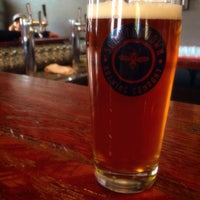 Photo taken at Scratchtown Brewing Company by Sara S. on 10/4/2014