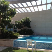 Photo taken at Crescent Rooftop Swimmimg Pool by BeenaColada on 10/11/2012