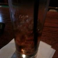 Photo taken at Slainte Irish Pub by Andrea J. on 1/29/2013